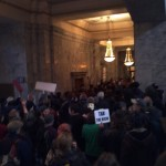 Massing against Gov. Gregoire in her Office. Olympia, WA. 11/28/2011. Photo by William Bass.