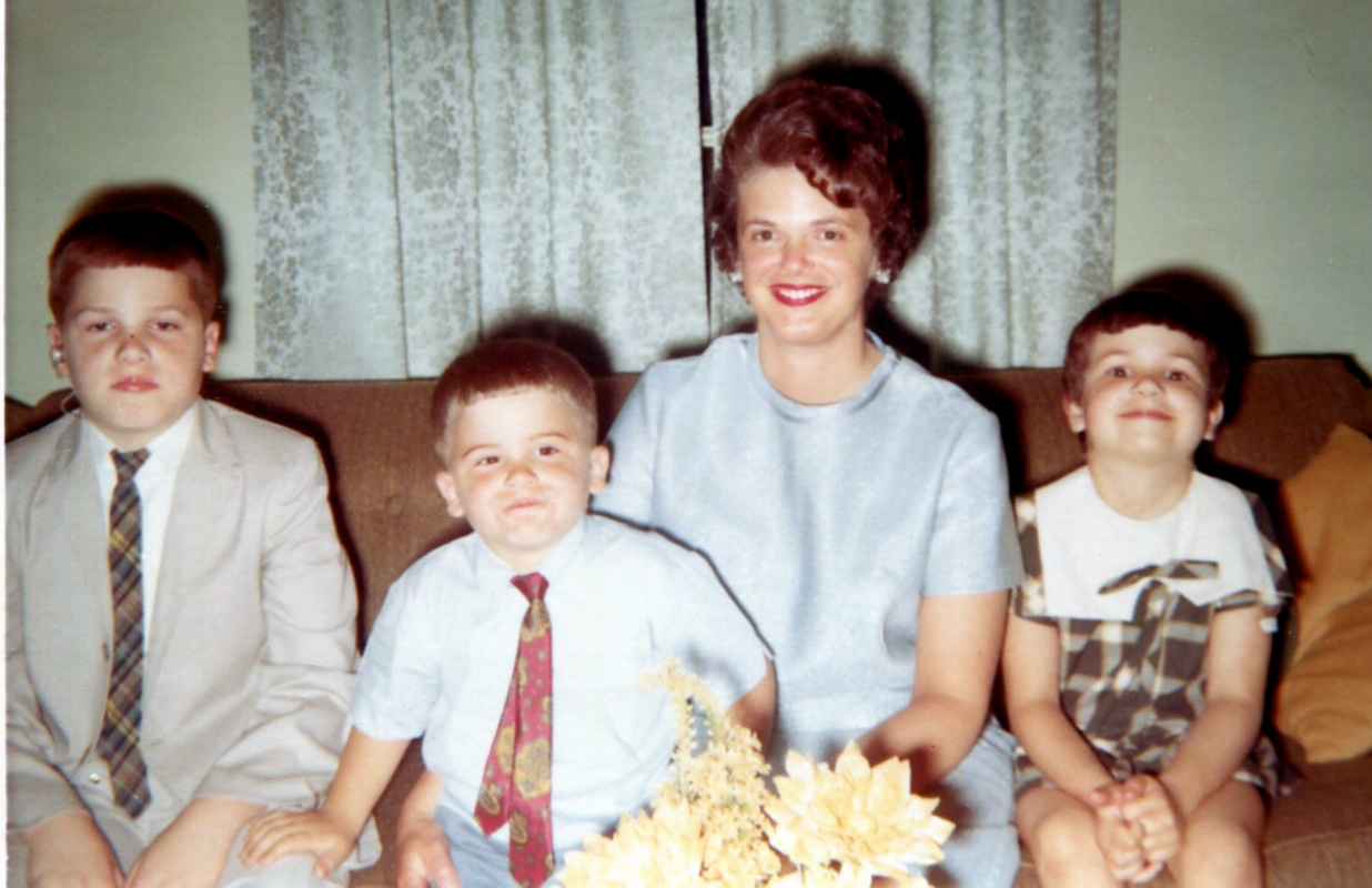 """Dudley"" and his family at home on the farm about 10 years later in 1970. Left to Right: William, his brother Joe, his mother Dot, & his sister Beth. I clearly did not want my picture taken, ha ha! Dad took our picture."