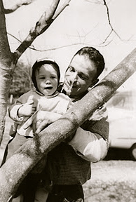 "William ""Dudley"" Bass at almost one year old, with his father, Bill Bass, 30 years old. Home on the family farm, Easter Sunday 17 April 1960."