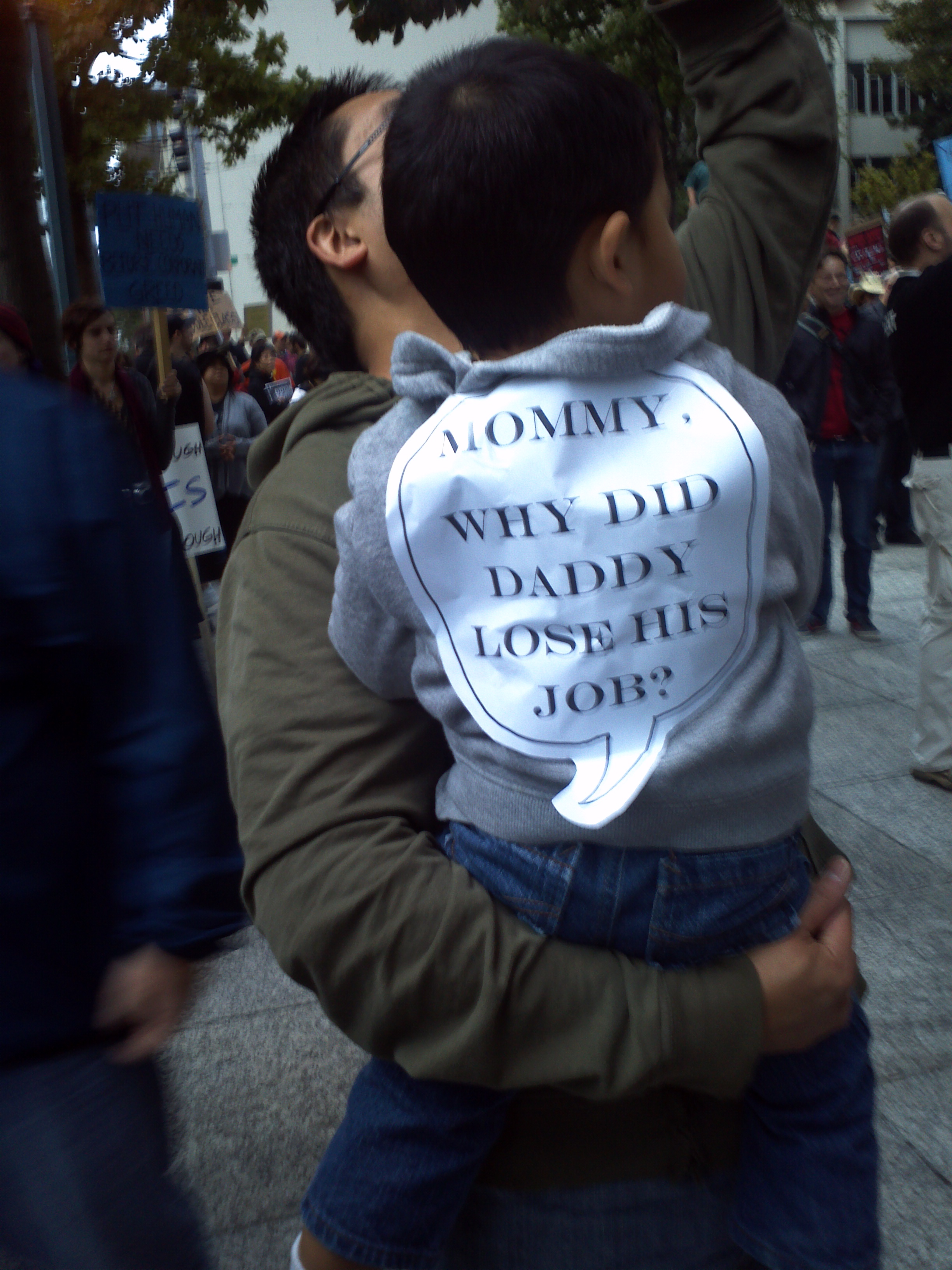 Father & Son at Westlake Plaza during the Occupy Seattle! Rally & March on Saturday 8 October 2011. Foto by William Bass.