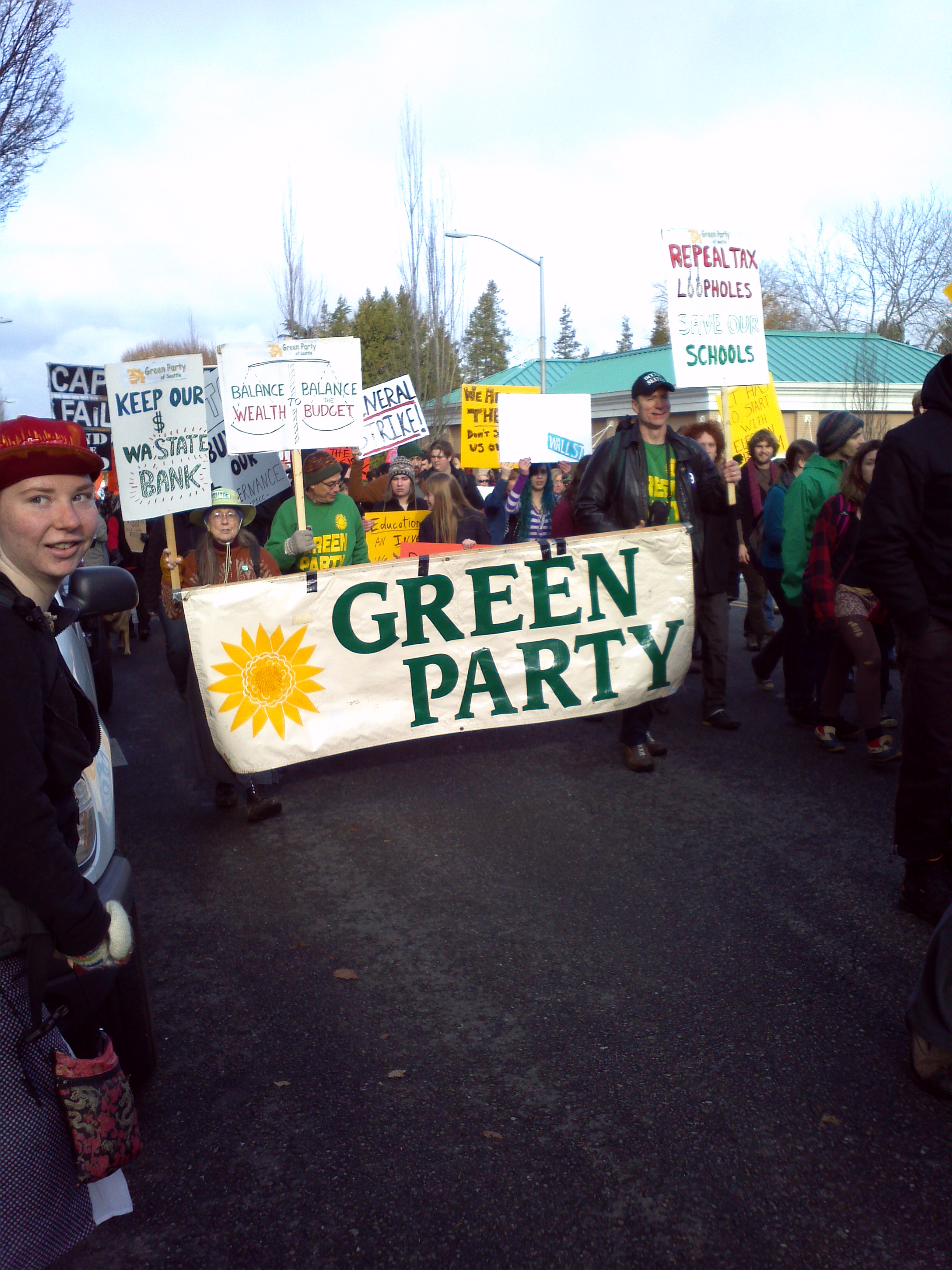 Green Party members march thru Olympia, Washington to Occupy the State Capital., Monday 28 November 2011.