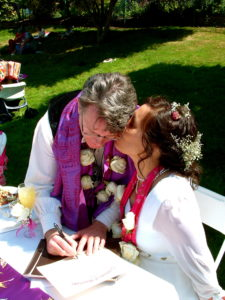 Signing the Certificate of Marriage & sealed with a kiss.