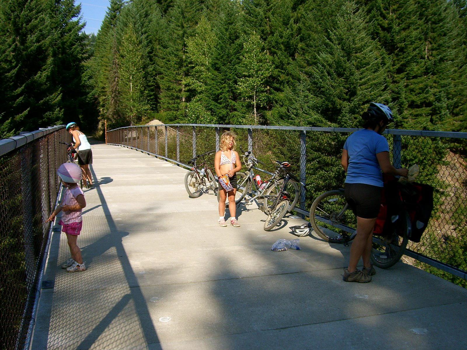 Long day as shadows fall. Family bike ride on the Iron Horsie Trail. Yummy Break over the Yakima River, Cascade Mountains, WA. Saturday 19 August 2006. Clockwise L2R: Talia, Morgan, Kate, & Kristina.