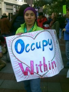 Occupy Within! With Love! Kristina marching in the Occupy Movement with about 30,000 others, Downtown Seattle, WA. Saturday 15 October 2011.