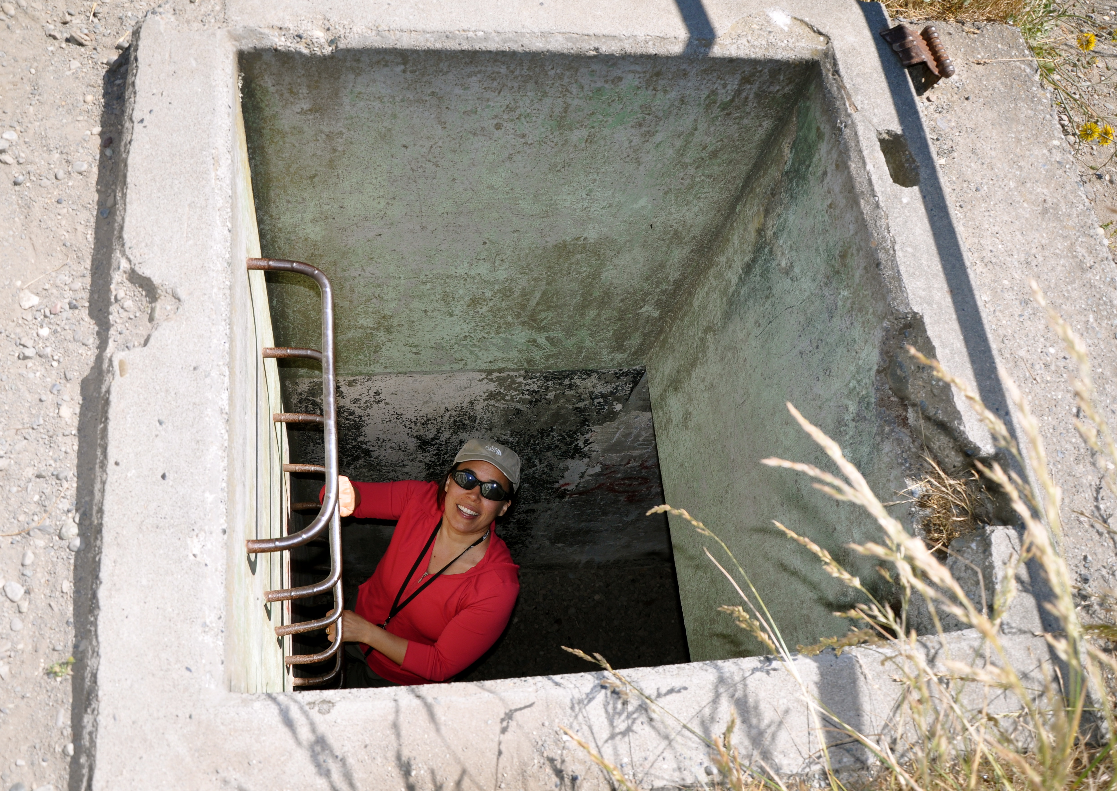 Kristina climbing into the old bunkers of Fort Ebey on Whidbey Island. Monday 4 July 2011.