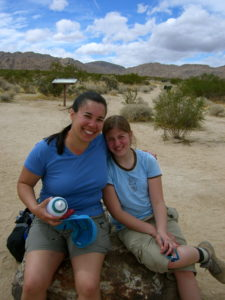 Morgan & Kristina celebrating the end of a rock climbing & backpacking trip in Joshua Tree, CA. March 2006.