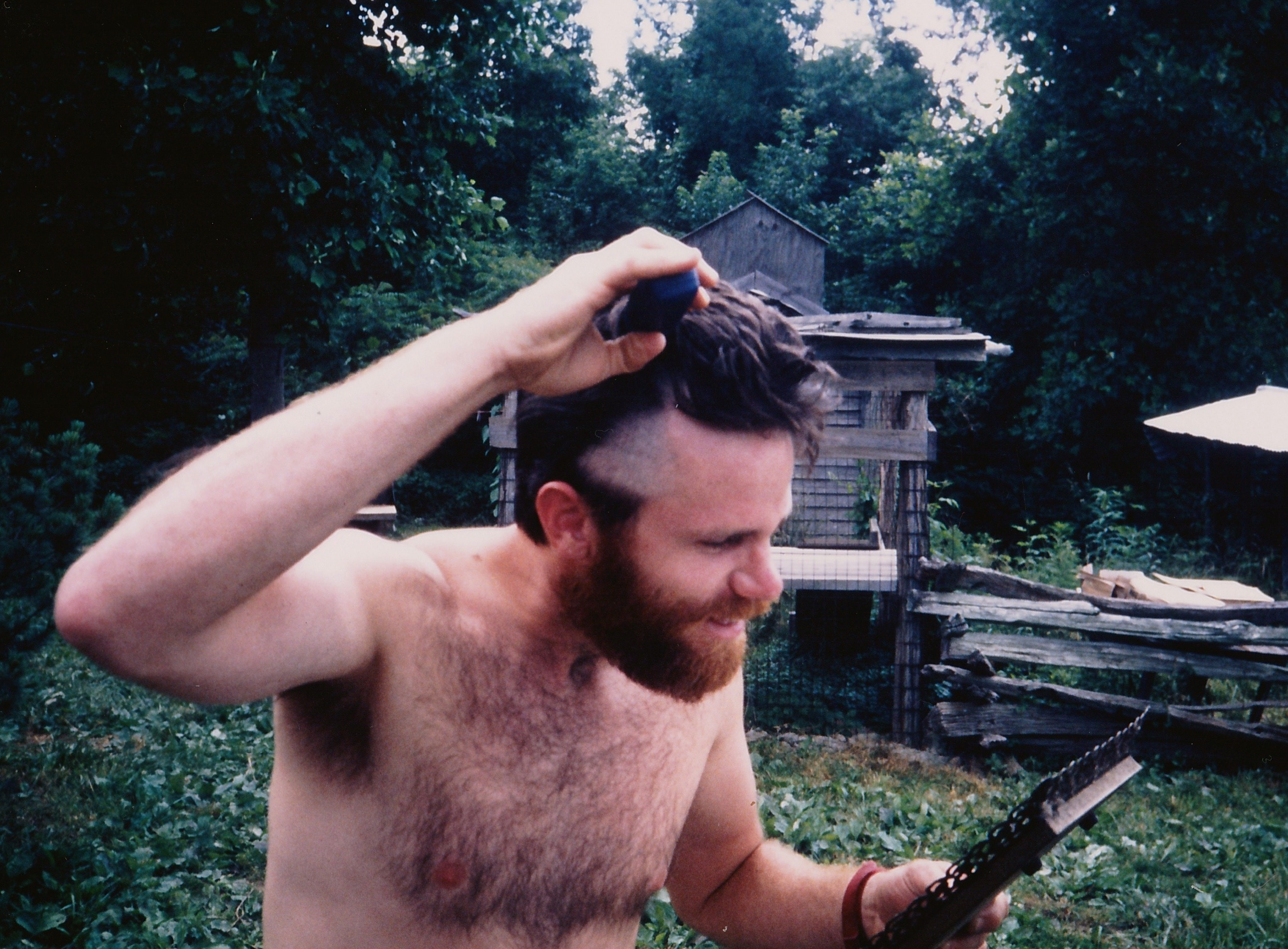 Beginning to shave my head during our sojourn at Rusty's just off the AT. Summer of 1991. Foto by Weather Carrot.