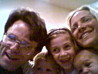 Gleeful Orcas: L2R: William, Kate, & Morgan Bass + Gwen Hughes w/ Baby Housemate Dylan Bradley, Orca Landing Cooperative, Seattle, WA. Self-Portrait. May 9, 2000.