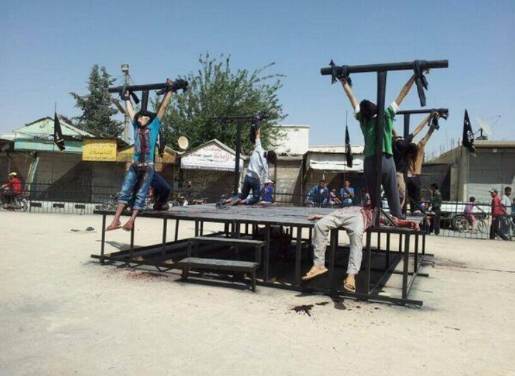 Twenty-first Century crucifixions: Muslim fighters from rival, more moderate anti-Assad rebels captured and executed by ISIL/ISIS/Da'esh/DAIISH/Islamic State in Deir Hafir, a town square in Aleppo, Syria, June 2014.