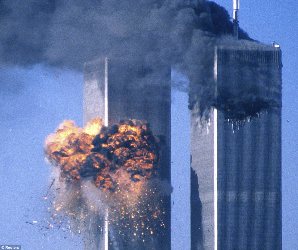 The Twin Towers of New York immediately after the second plane hits. Reuters.