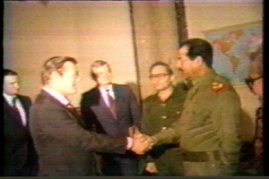 "Donald Rumsfeld, President Reagan's Special Envoy to the Middle East, shakes hands with Saddam Hussein in support of Iraq in its war against Iran, December 1983, seven years before Saddam got the so-called ""secret green light"" from the U.S. to invade Kuwait."