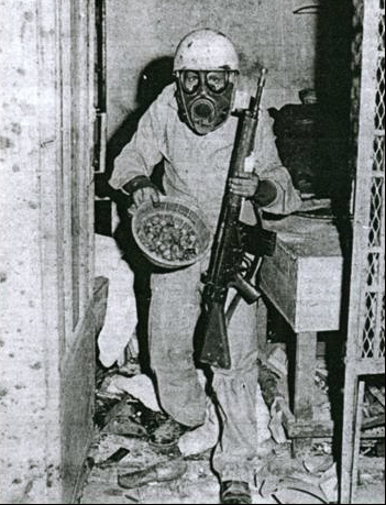 A Saudi soldier down in the Qaboo Underground with a basket of dates taken from the rebel jihadists, the Siege of the Grand Mosque, Battle of Mecca, 1979.