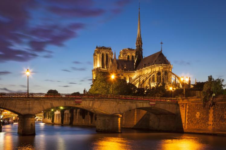 The Cathédral Notre Dame de Paris at dusk. From free fotostock via Getty.