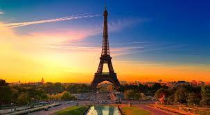 Paris, Paris, Paris! The Eiffel Tower dominates the landscape. From a free wallpaper & screensaver site.